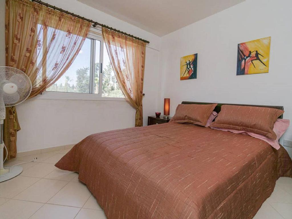 A bed or beds in a room at Pafilia Garden Apartments