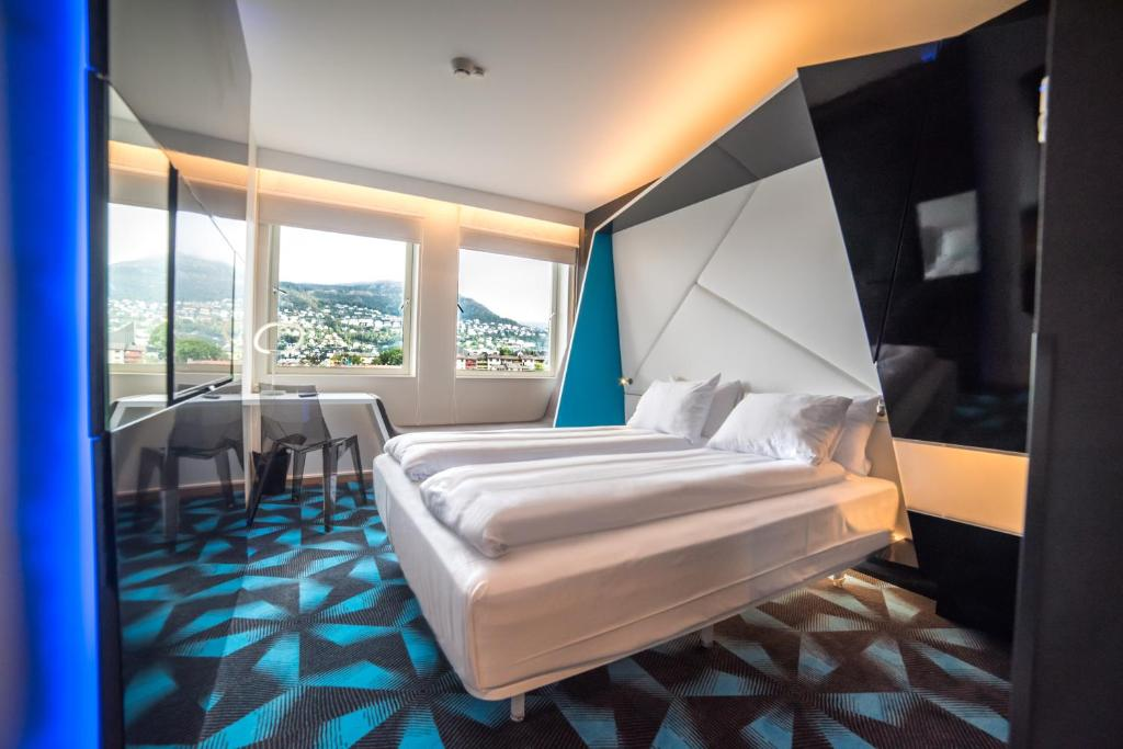 A bed or beds in a room at Magic Hotel Solheimsviken