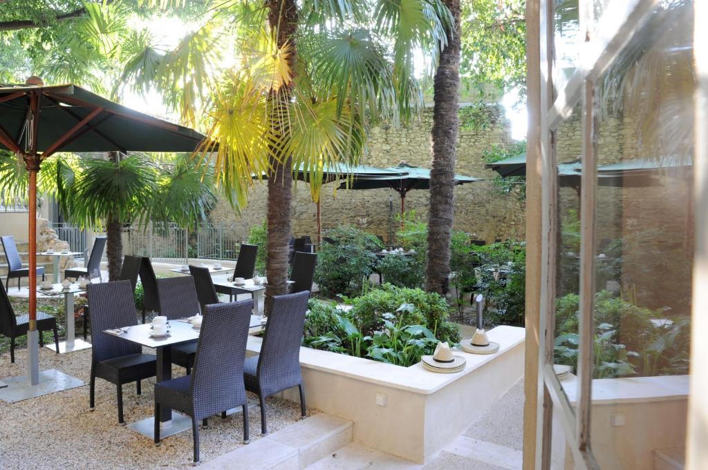 Restaurant ou autre lieu de restauration dans l'établissement Hotel Spa Le Calendal