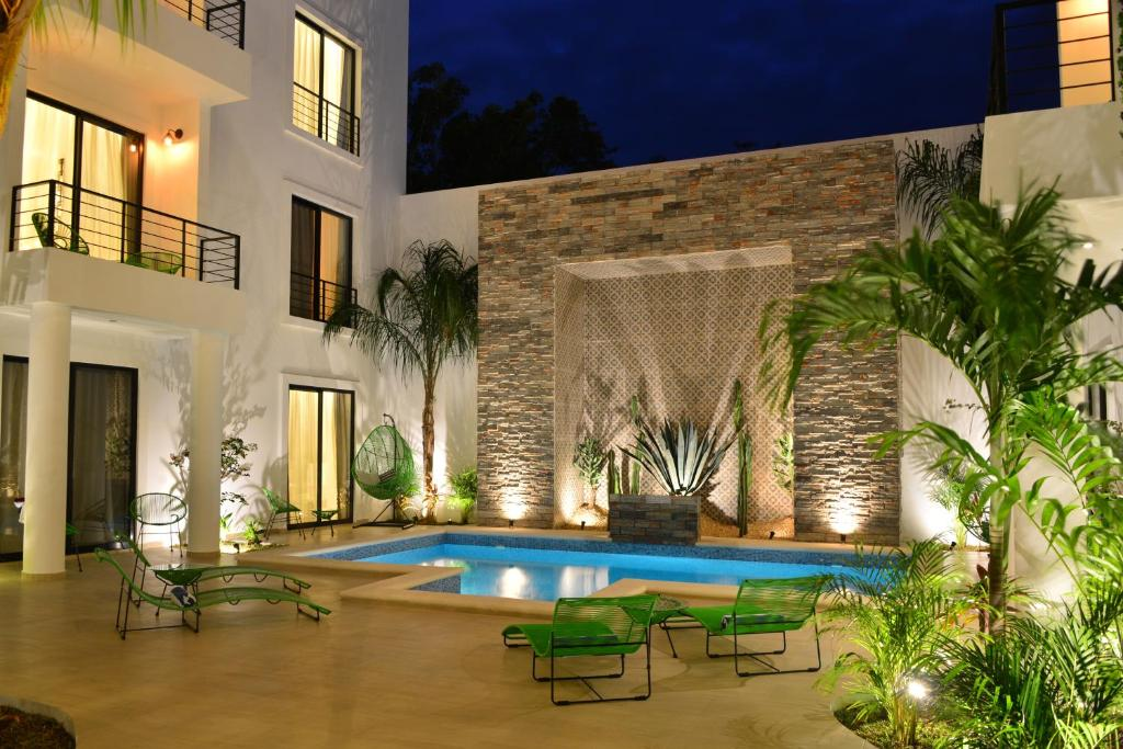 The swimming pool at or near Elements Tulum Boutique Hotel