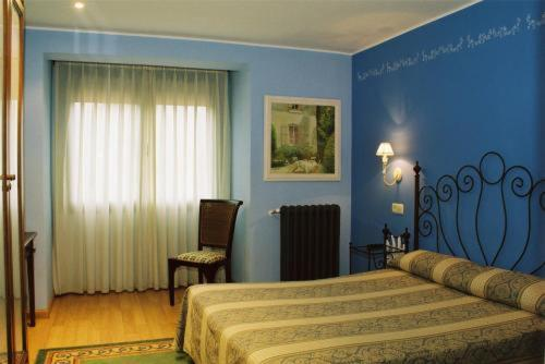 A bed or beds in a room at Hotel Conventin