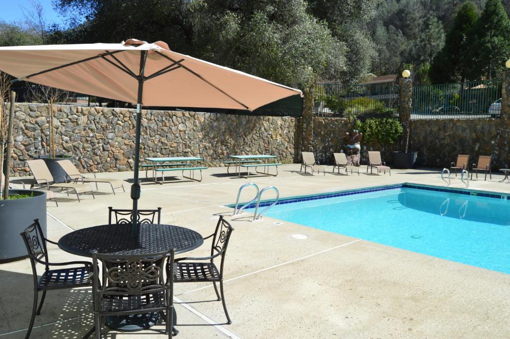 The swimming pool at or near Cedar Lodge