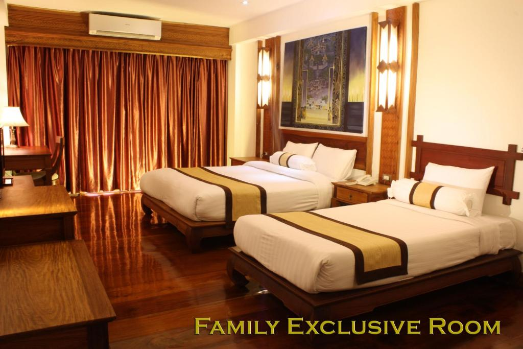 Cama o camas de una habitación en Chanthapanya Hotel