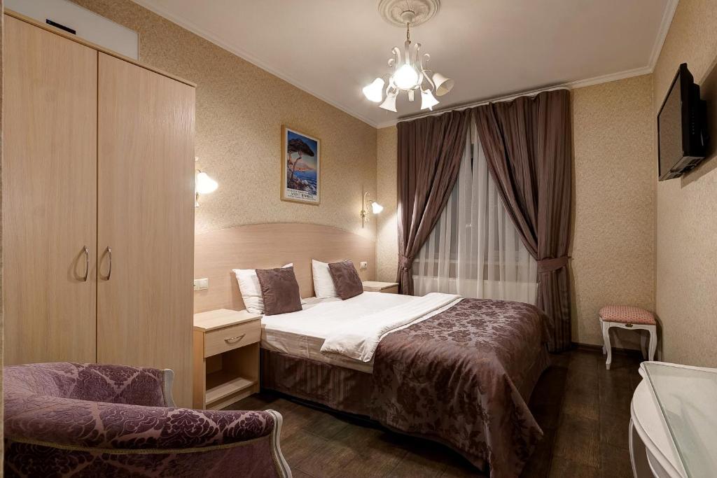 Кровать или кровати в номере Гостевой Дом «Тиара Домодедово»