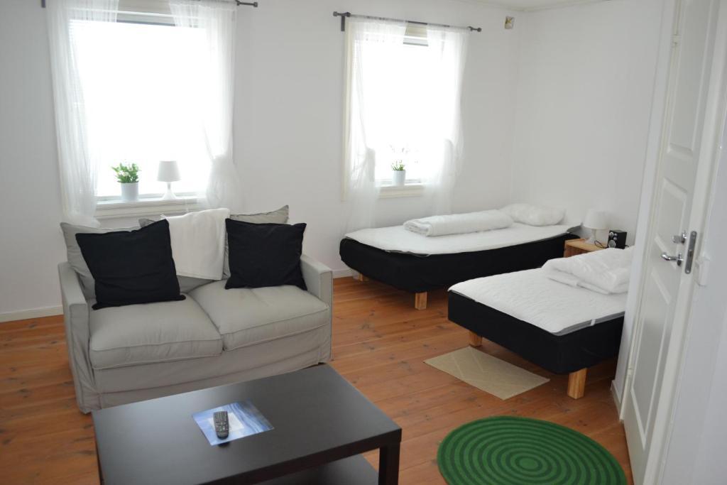 Säng eller sängar i ett rum på Berggårdens Gästgiveri