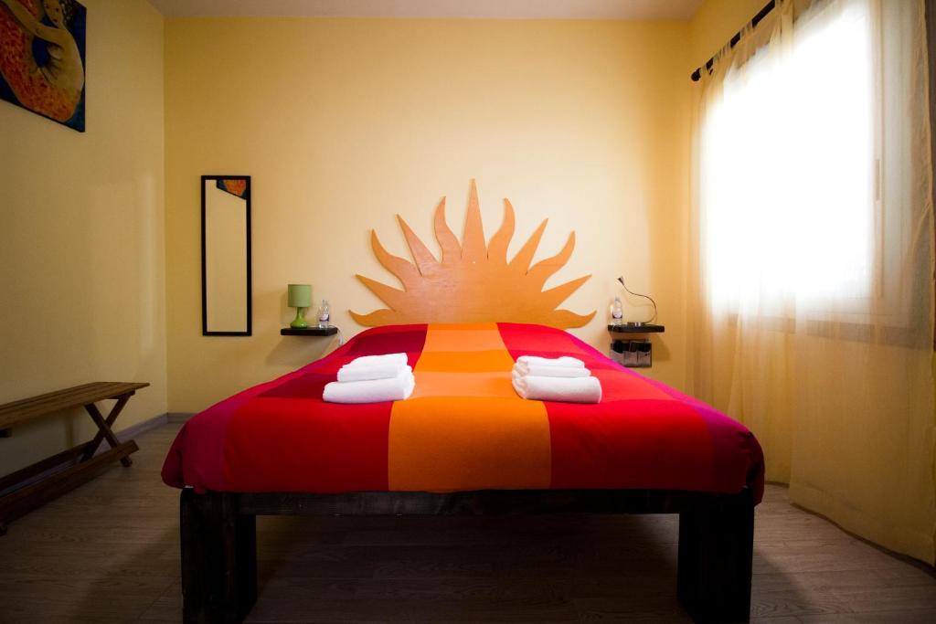 Letto o letti in una camera di B&B San Leone