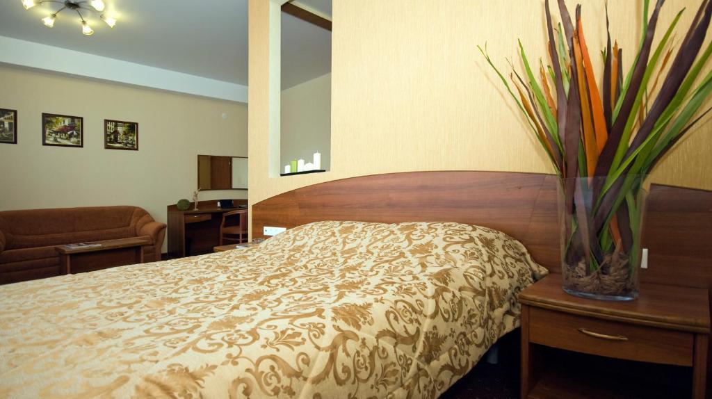 Кровать или кровати в номере Апарт-отель