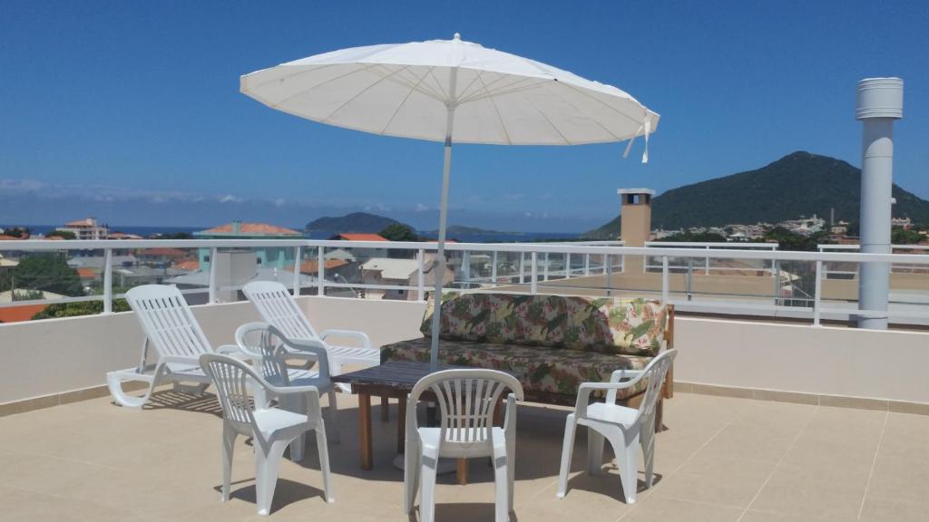 Uma varanda ou terraço em Cobertura Praia Dos Ingleses
