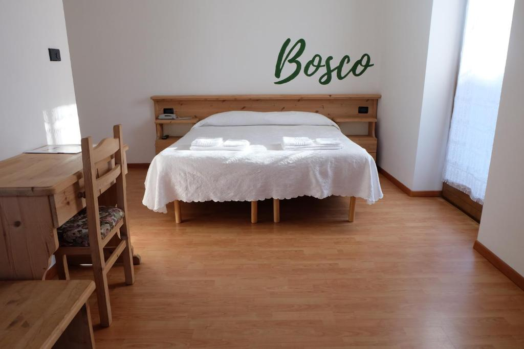 A bed or beds in a room at Santorsola Relax Hotel
