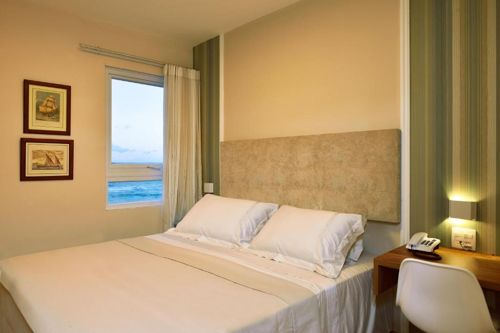 A bed or beds in a room at Rede Andrade Express