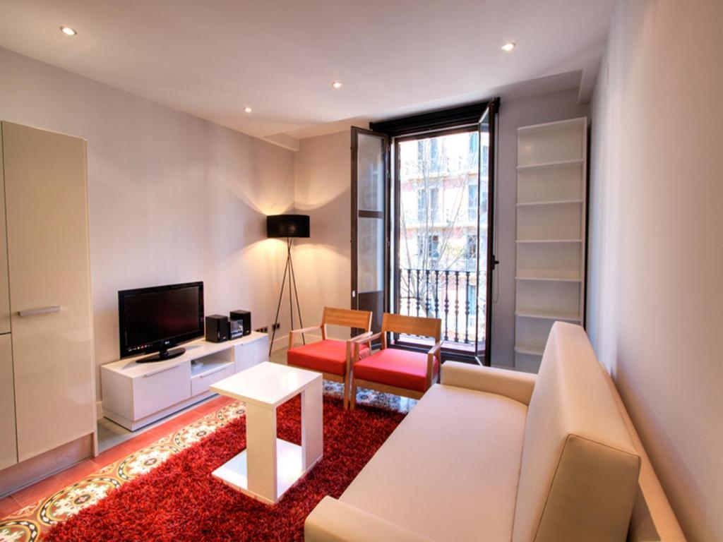 A seating area at Tamarit Apartments