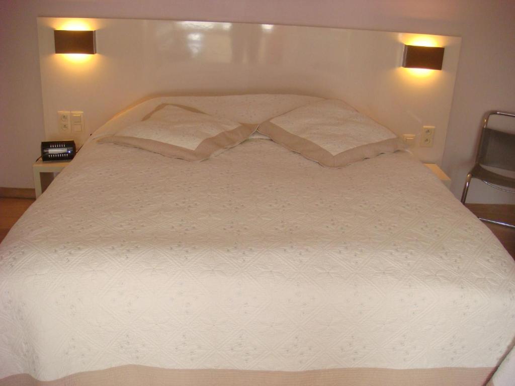 Een bed of bedden in een kamer bij Gastenkamers Centersuites