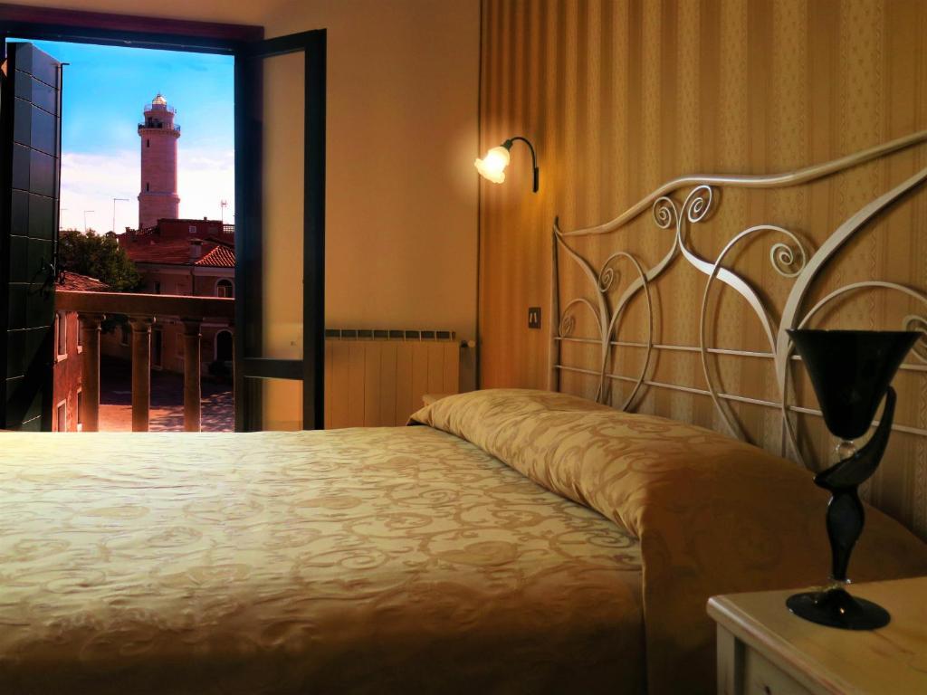 A bed or beds in a room at Al Soffiador