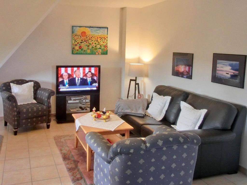 Ein Sitzbereich in der Unterkunft Villa Hermes