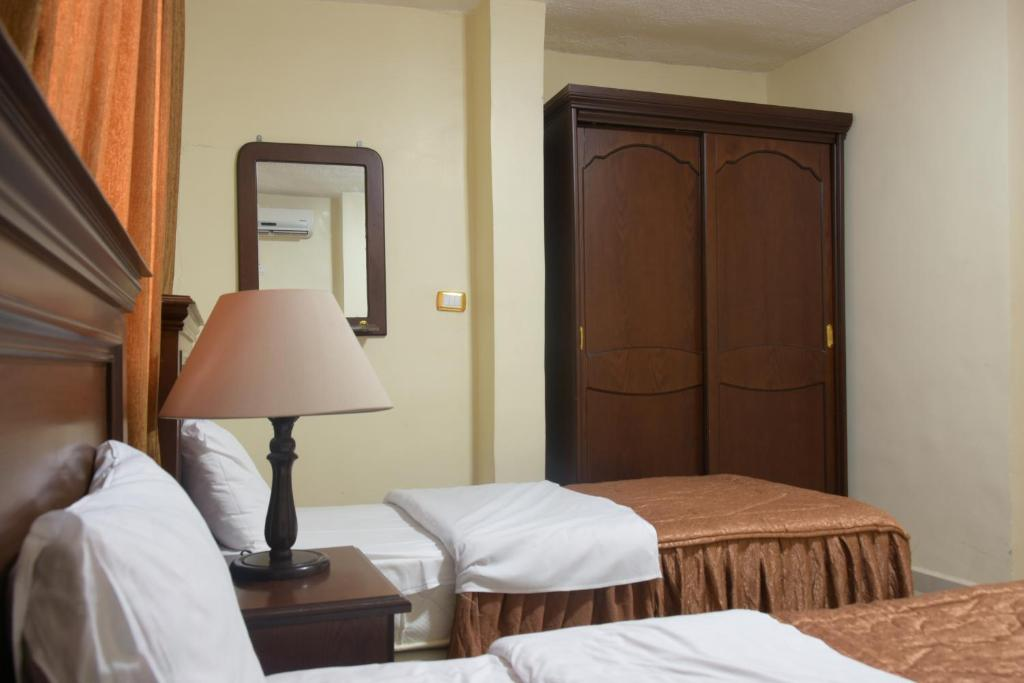 A bed or beds in a room at Cleopetra Hotel