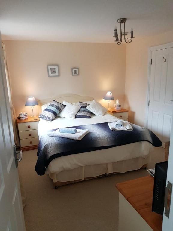 A bed or beds in a room at The Brambles B&B