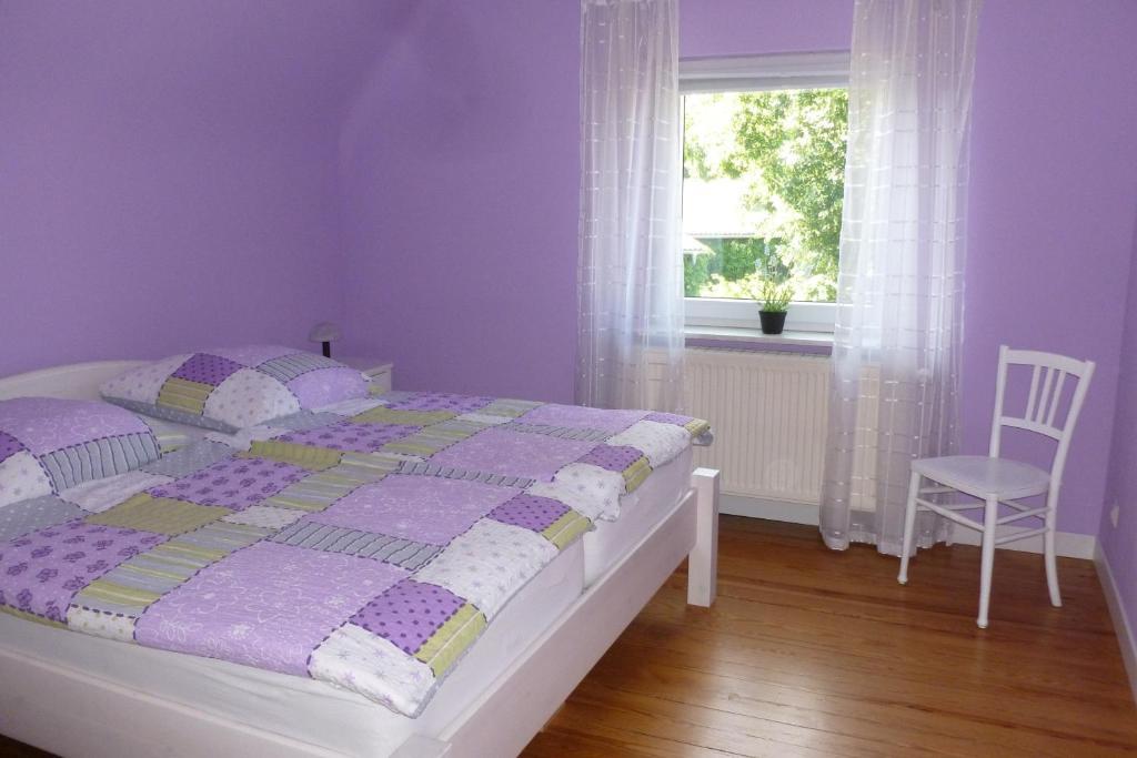 Кровать или кровати в номере Ferienwohnung Sommer
