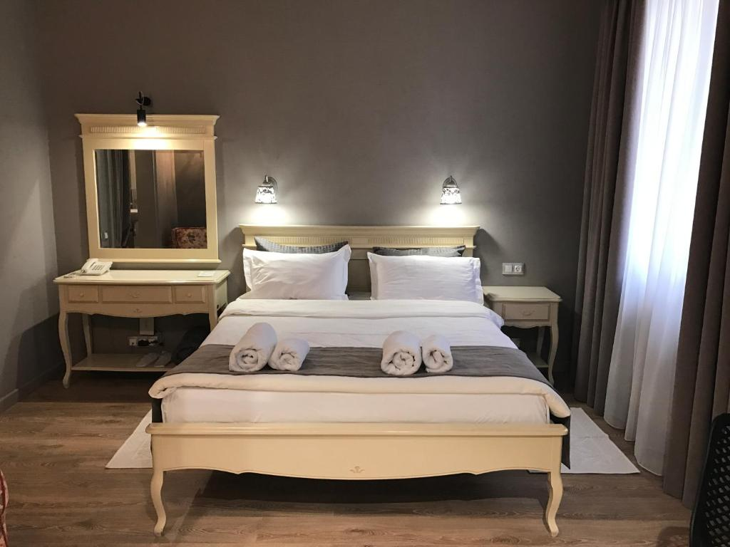 A bed or beds in a room at Aparthotel