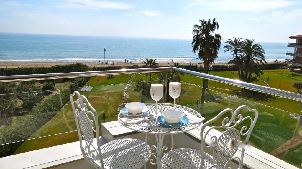 A balcony or terrace at Gava Beach 1st Line