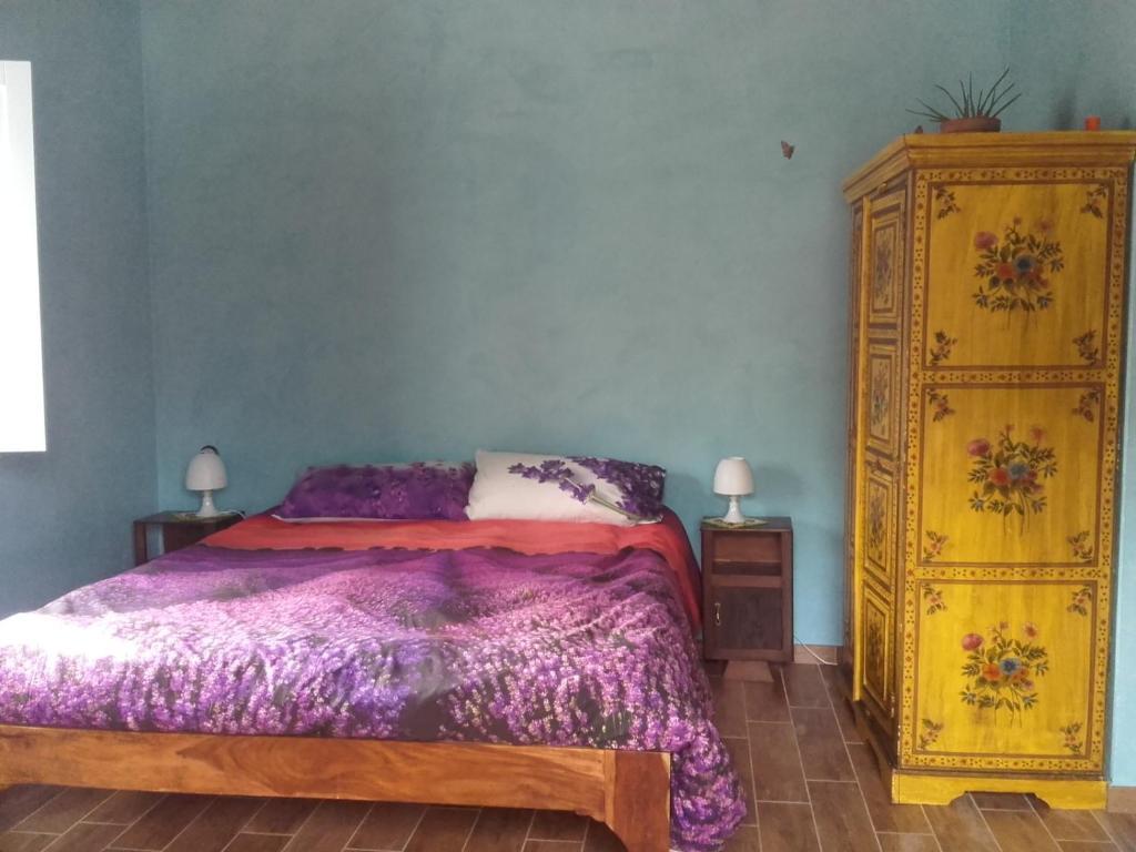 Cama o camas de una habitación en Rifugio Nel Bosco