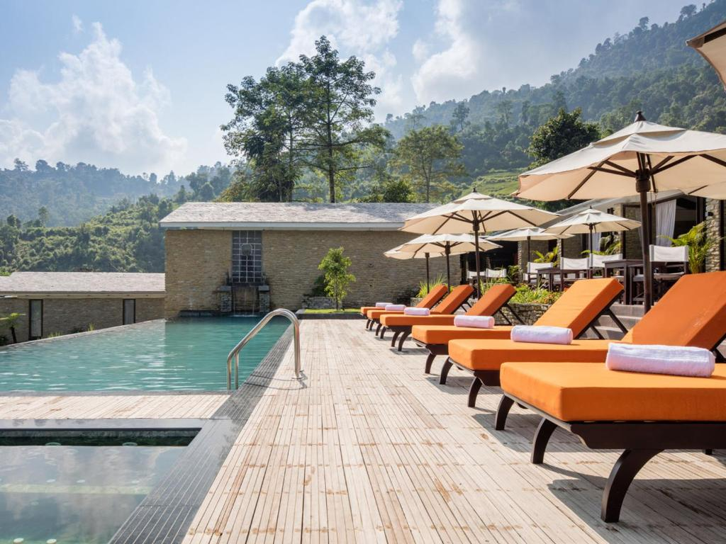 The swimming pool at or near The Pavilions Himalayas The Farm