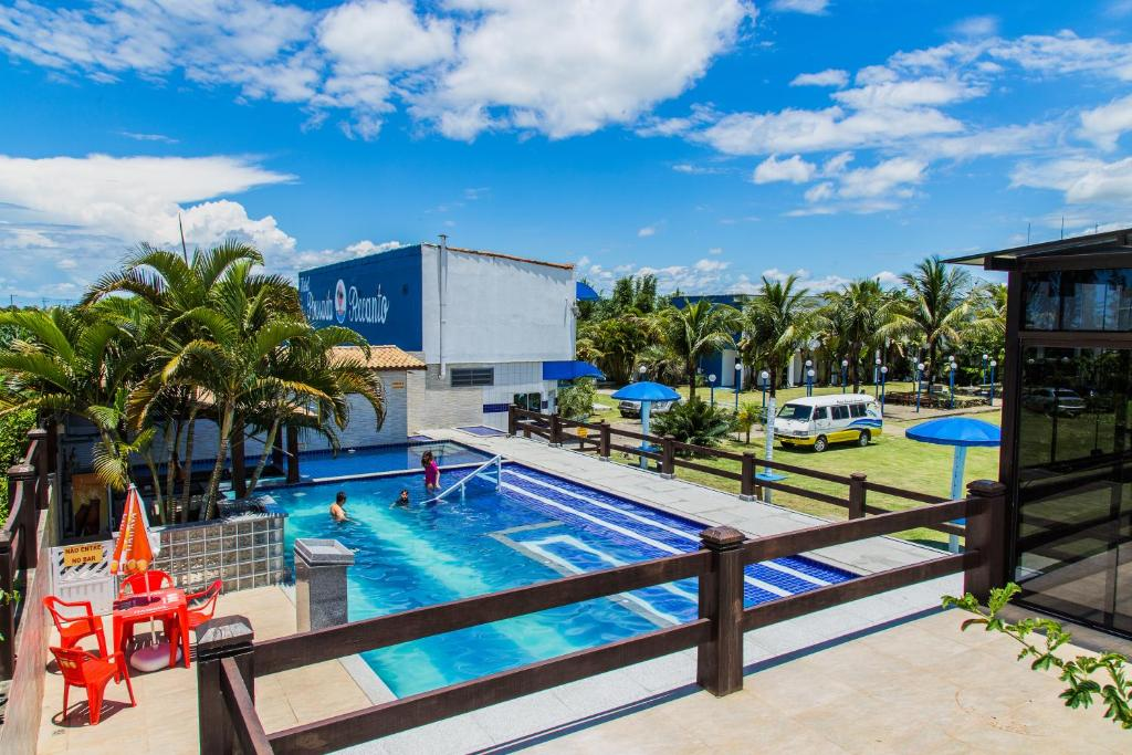 The swimming pool at or near Hotel Pousada Recanto