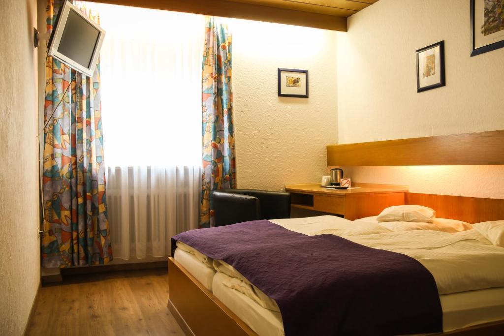 Ein Bett oder Betten in einem Zimmer der Unterkunft Hotel Waldlust B&B