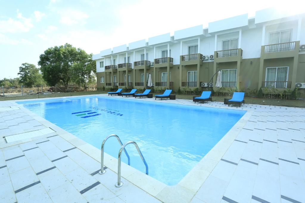 The swimming pool at or near WH Hotel & Service Apartment