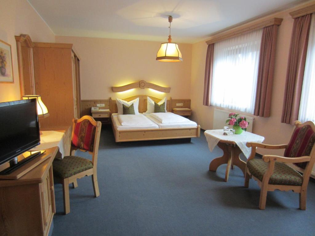 Ein Bett oder Betten in einem Zimmer der Unterkunft Hotel Plainbrücke | self check-in