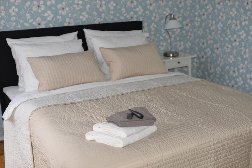 A bed or beds in a room at Bed and Breakfast Loft24