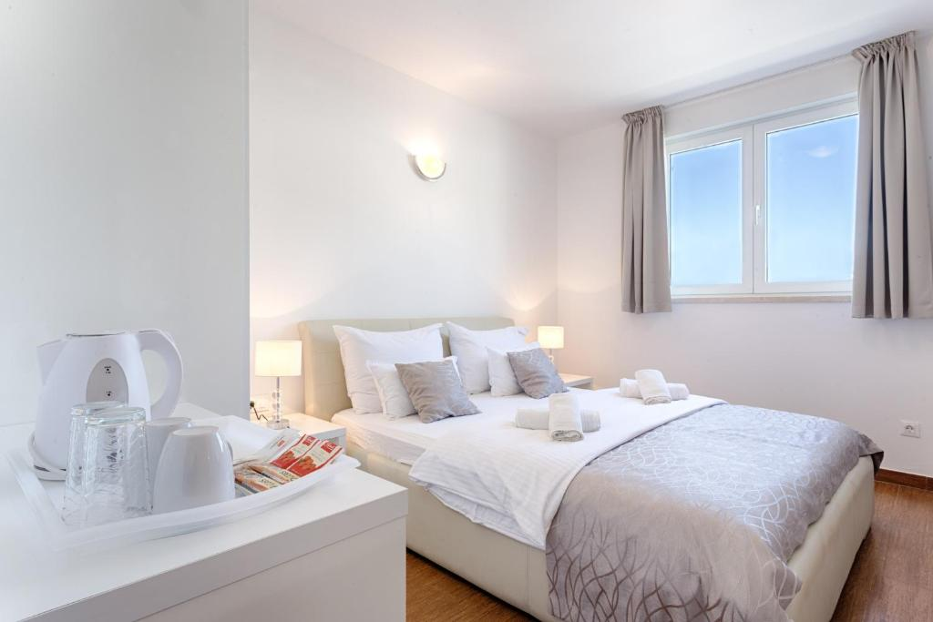 A bed or beds in a room at Adriatic Queen Villa