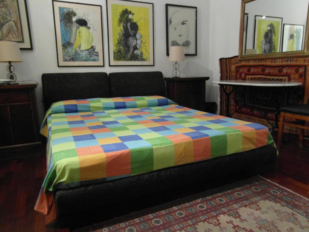 A bed or beds in a room at Abitazione Pigneto B&B