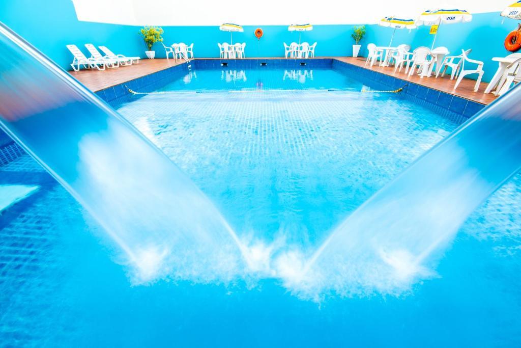 The swimming pool at or near Dan Inn Foz do Iguaçu