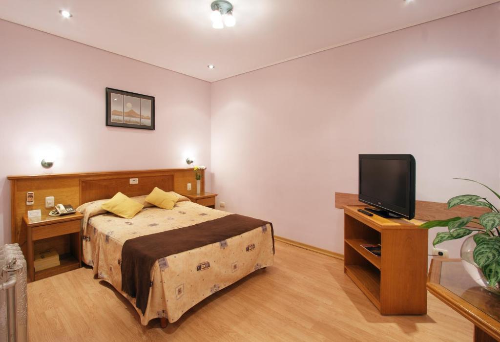 Кровать или кровати в номере Gran Hotel De La Paix