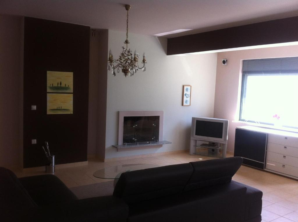 A seating area at Chrysis Apartments