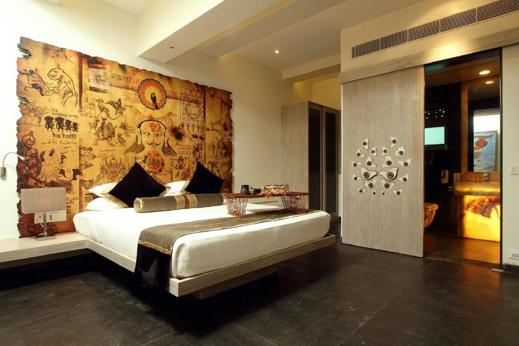 A bed or beds in a room at Le Sutra Hotel