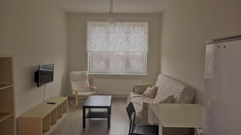 Гостиная зона в Apartment Otrada