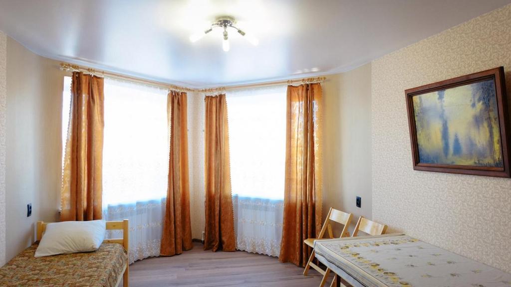 Кровать или кровати в номере Apartment on Leninskiy prospekt 150