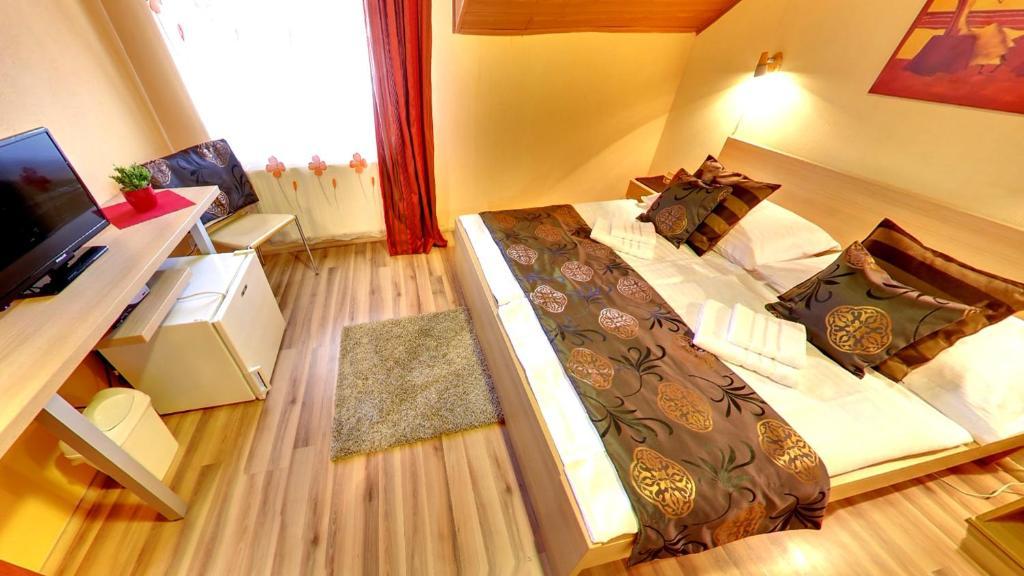 Ein Bett oder Betten in einem Zimmer der Unterkunft Penzion Siesta