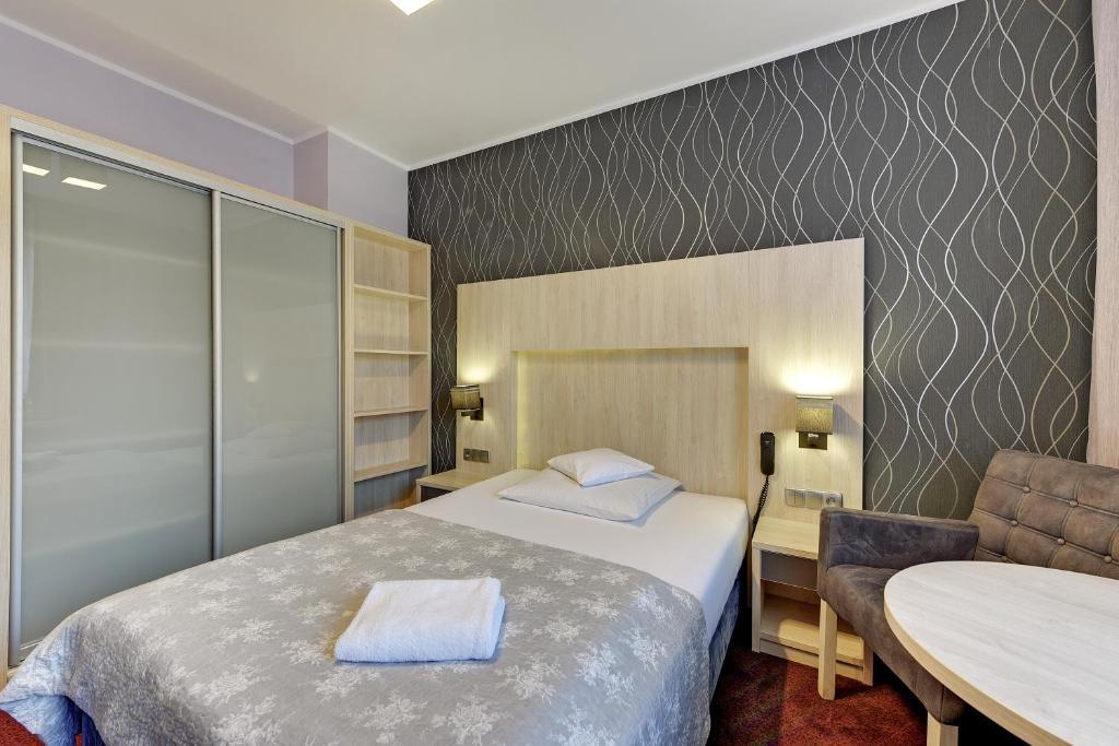 Łóżko lub łóżka w pokoju w obiekcie Abak
