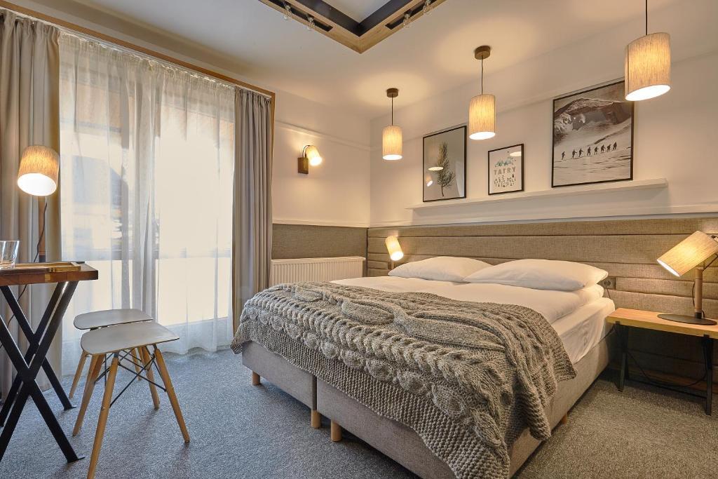 Кровать или кровати в номере Pensjonat Tatry