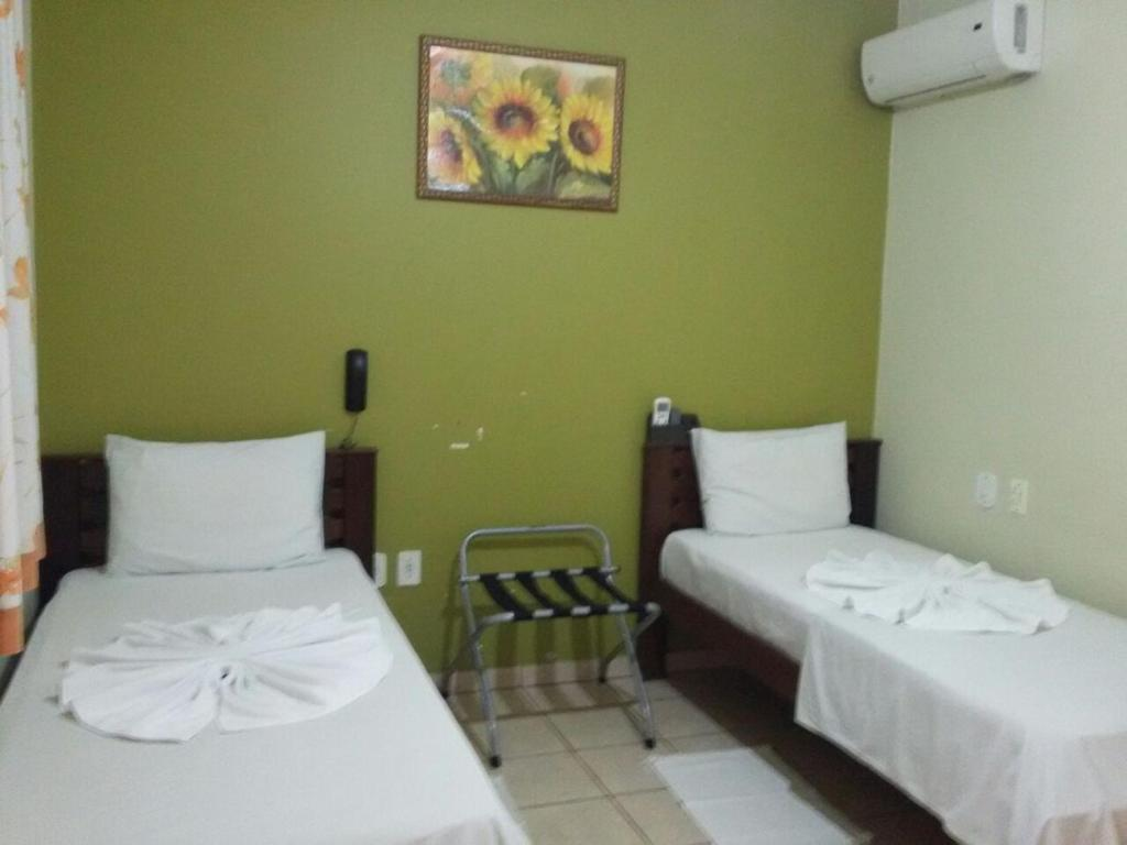A bed or beds in a room at Dominique Hotel