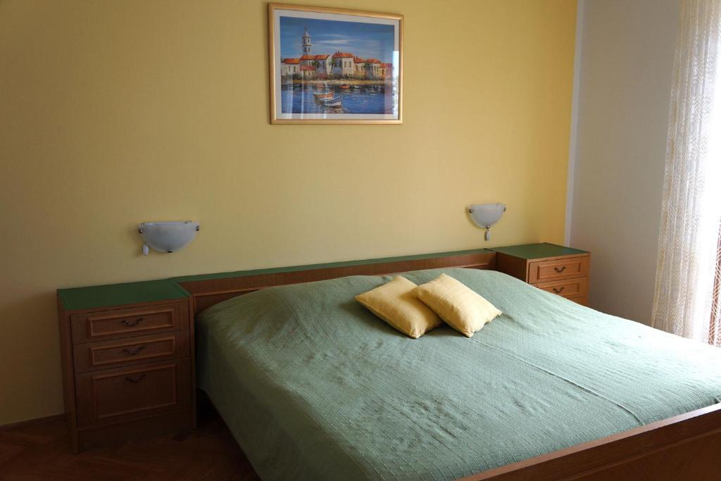 A bed or beds in a room at Guest House Međine
