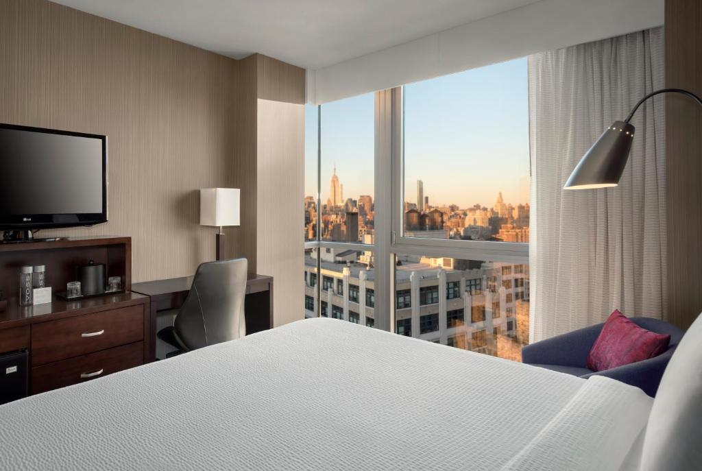 A bed or beds in a room at Courtyard by Marriott New York Manhattan / Soho