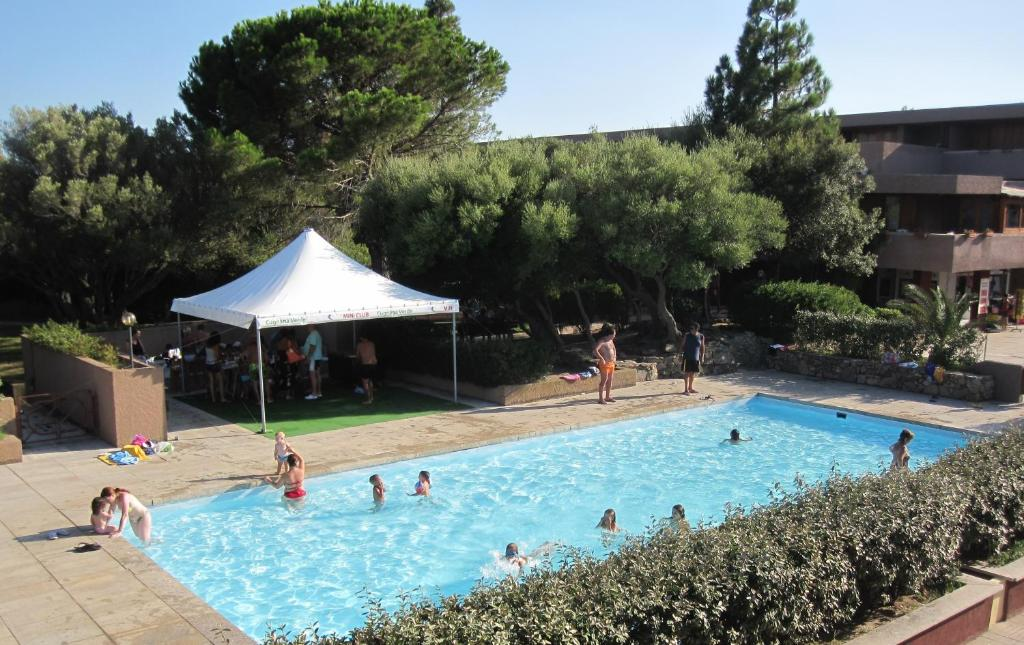 A view of the pool at Centro Vacanze Cugnana Verde or nearby