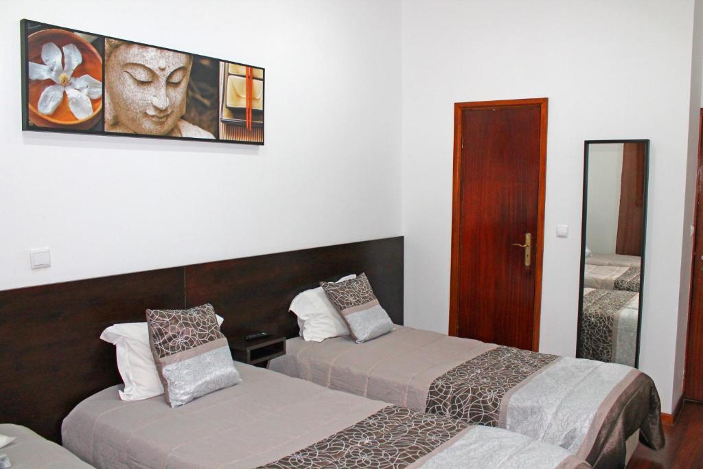 Ein Bett oder Betten in einem Zimmer der Unterkunft D. Duarte I