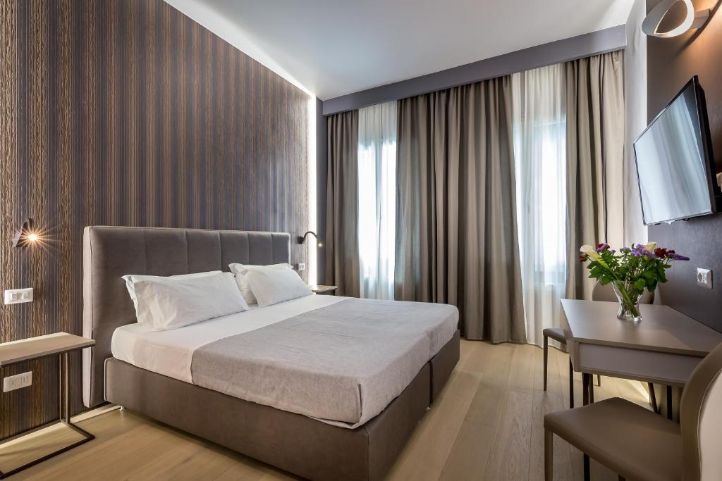 A bed or beds in a room at Blu Notte Guest House