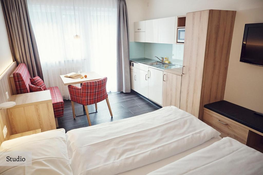 A bed or beds in a room at Serviced Apartments by Solaria