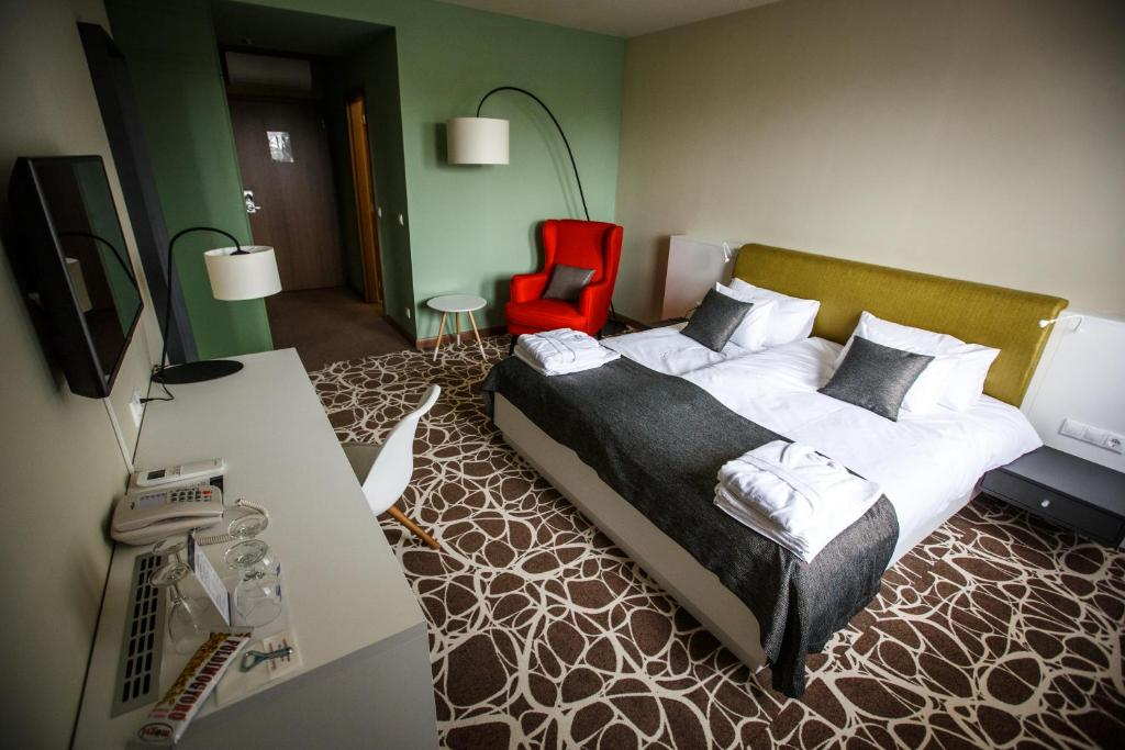 A bed or beds in a room at Hotel Bassiana