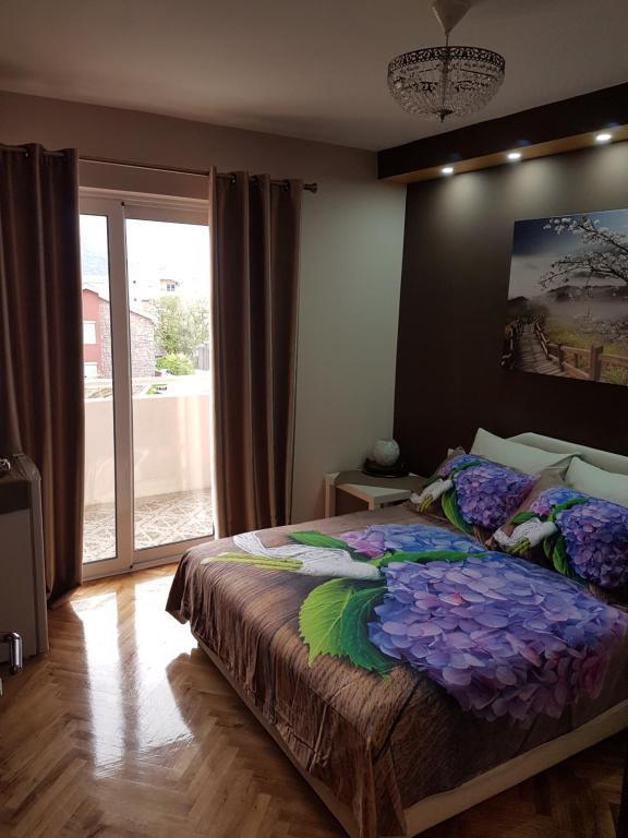 Apartments Vila Galileo tesisinde bir odada yatak veya yataklar